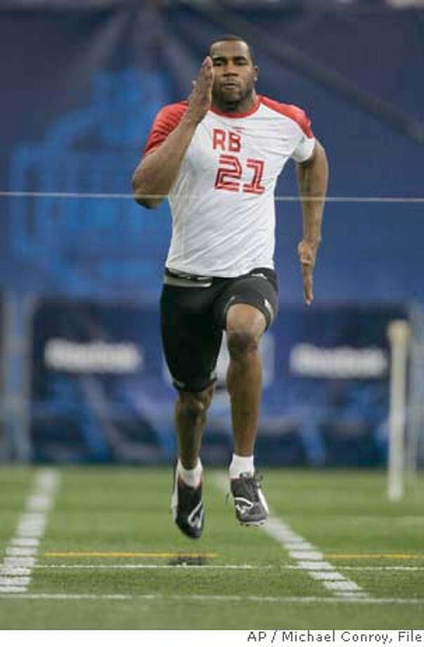 ###Live Caption:** FILE **Running back Darren McFadden, of Arkansas, runs the 40-yard dash at the NFL Combine in this Feb. 24, 2008 file photo in Indianapolis. In a couple weeks McFadden will realize a football player's dream. The star running back out of Arkansas is expected to be one of the first players drafted in the 2008 NFL Draft. (AP Photo/Michael Conroy, File)###Caption History:** FILE **Running back Darren McFadden, of Arkansas, runs the 40-yard dash at the NFL Combine in this Feb. 24, 2008 file photo in Indianapolis. In a couple weeks McFadden will realize a football player's dream. The star running back out of Arkansas is expected to be one of the first players drafted in the 2008 NFL Draft. (AP Photo/Michael Conroy, File)###Notes:Darren McFadden###Special Instructions:FEB. 24, 2008 FILE ** EFE OUT EFE OUT Photo: Michael Conroy