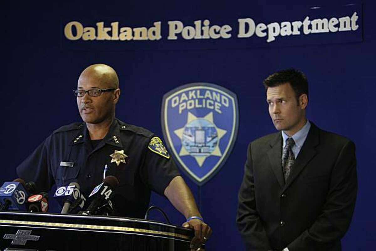 Howard Jordan, left, the acting Oakland police chief, reads a statement regarding the Hassani Campbell criminal investigation as Jeff Thomason, right, the police public information officer listens during a news conference in Oakland, Calif., Tuesday, Sept. 1, 2009. Criminal charges will not be filed against an Oakland man who was arrested on suspicion of murdering his fiancee's disabled foster child. Alameda County Assistant District Attorney Tom Rogers says there's insufficient evidence against Louis Ross in the Aug. 10 disappearance of Hasanni Campbell, of Fremont, Calif. (AP Photo/Eric Risberg)