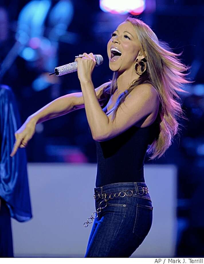 "Mariah Carey performs at the ""Idol Gives Back"" fundraising special of ""American Idol"" in Los Angeles on Sunday April 6, 2008. (AP Photo/Mark J. Terrill) Photo: Mark J. Terrill, AP"