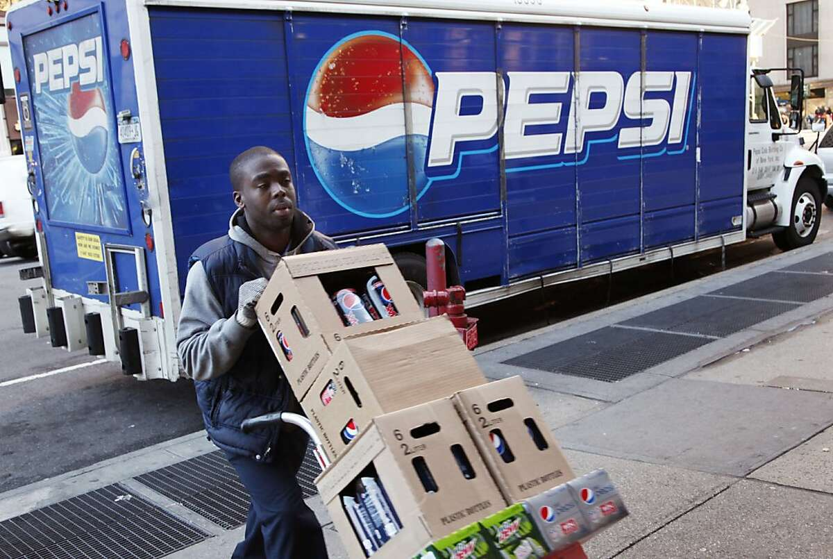 Kandral McKenzie delivers Pepsi products, Thursday, Feb. 9, 2012 in New York. PepsiCo says it will cut 8,700 jobs in a cost-cutting move as it increases investment in advertising and marketing in North America. (AP Photo/Mark Lennihan)
