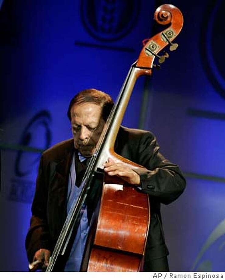 """Cuban musicians Israel """"Cachao"""" Lopez performs during the Cassandra awards in Santo Domingo, in this March 10, 2008 file photo. A family spokesman said Cachao, 89, died in a Miami-area hospital early Saturday, March 22, 2008. The bassist is widely credited as a pioneer of the mambo. (AP Photo/Ramon Espinosa). Photo: Ramon Espinosa"""