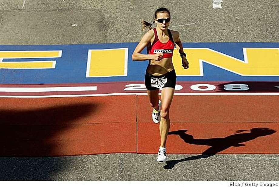BOSTON - APRIL 20:  Magdalena Lewy-Boulet crosses the finish line during the U.S. Women's Olympic Marathon Trials April 20,2008 in Boston, Massachusetts. Lewy-Boulet finished second.  (Photo by Elsa/Getty Images) Photo: Getty Images