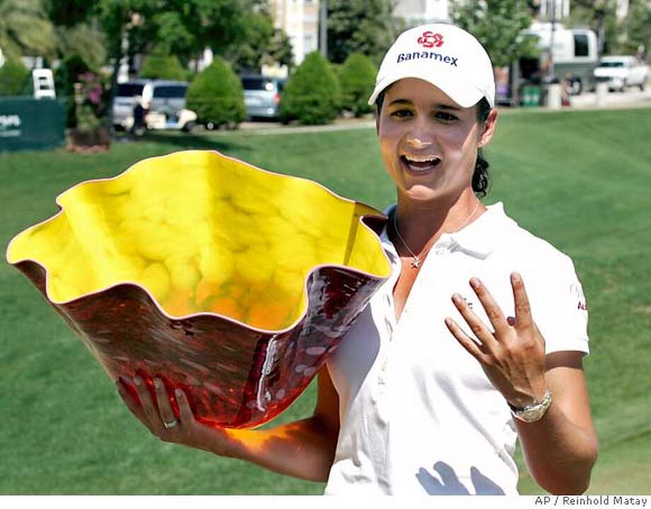 ###Live Caption:Lorena Ochoa, of Mexico, holds up the Kelly Jo Dowd championship trophy along with four fingers to signify her four-straight LPGA wins on 18th hole following the final round of the Ginn Open LPGA Golf Tournament in Kissimmee, Fla., Sunday, April 20, 2008. (AP Photo/Reinhold Matay)###Caption History:Lorena Ochoa, of Mexico, holds up the Kelly Jo Dowd championship trophy along with four fingers to signify her four-straight LPGA wins on 18th hole following the final round of the Ginn Open LPGA Golf Tournament in Kissimmee, Fla., Sunday, April 20, 2008. (AP Photo/Reinhold Matay)###Notes:Lorena Ochoa###Special Instructions:EFE OUT Photo: Reinhold Matay