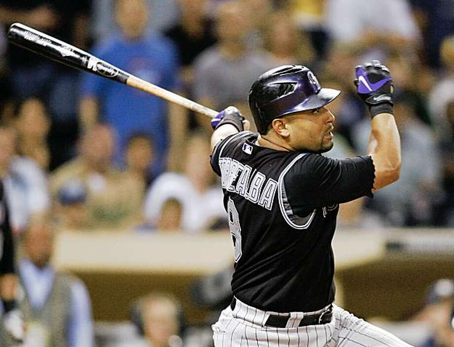Colorado Rockies' Yorvit Torrealba follows through on an RBI-double hit off of San Diego Padres pitcher Heath Bell during the ninth inning of a baseball game Friday, Sept. 11, 2009 in San Diego. The Rockies won 4-1.  (AP Photo/Denis Poroy) Photo: Denis Poroy, AP