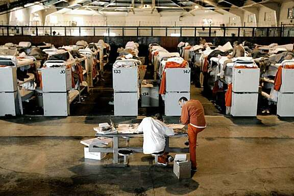 ** FILE ** Inmates are seen housed in three tier bunks, in what was once a multi-purpose recreation room, at the Deuel Vocational Institute in Tracy, Calif., in this Aug. 3, 2006, file photo. Sacramento Superior Court Judge Gail Ohanesian heard arguments Friday, Feb. 15, 2006, in a lawsuit filed by two public employees unions against Gov. Arnold Schwarzenegger's plan to send California inmates to private prison out of state to help relieve overcrowding. (AP Photo/Rich Pedroncelli)