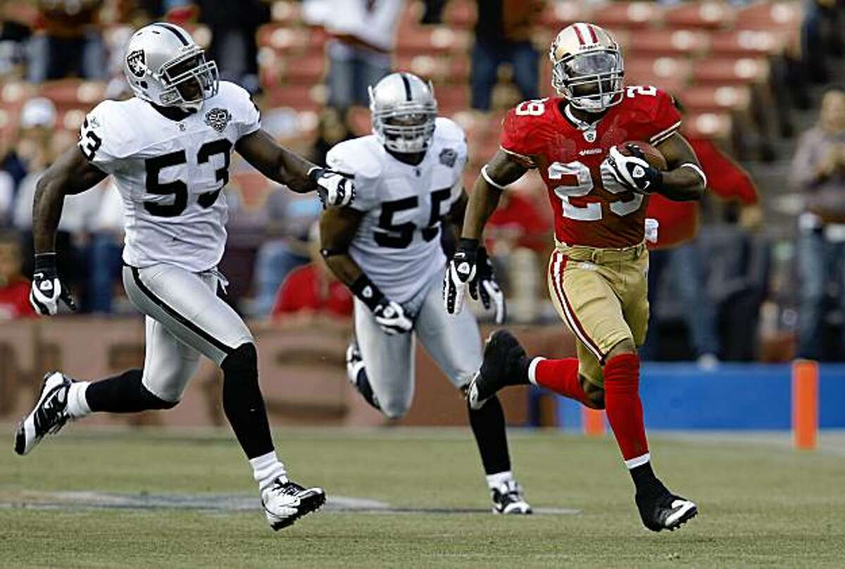 San Francisco 49er Glen Coffee (29) with a big pick up in the second quarter, chased by Oakland Raider Thomas Howard (53) and Oakland Raider Jon Alston (55) as the San Francisco 49ers take on the Oakland Raiders at Candlestick Park in San Francisco, Calif., on Saturday August 22, 2009, in a pre-season game.