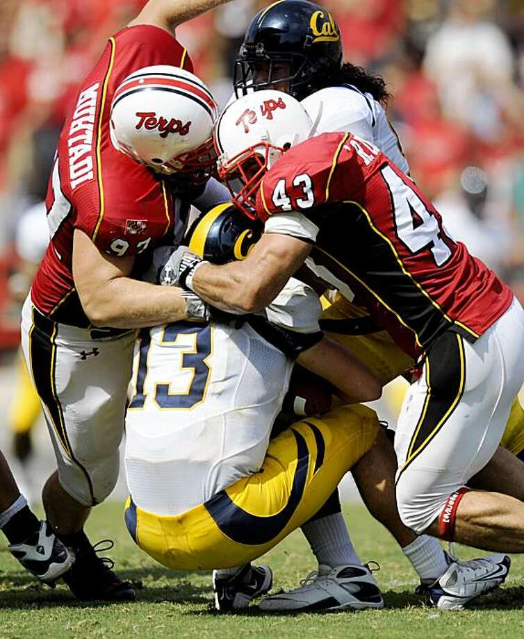 California quarterback Kevin Riley (13) is sacked by Maryland defensive tackle Dean Muhtadi (97) and linebacker Rich Coata (43) during the third quarter of an NCAA college football game Saturday, Sept. 13, 2008, in College Park, Md. Maryland won 35-27. (AP Photo/Nick Wass) Photo: Nick Wass, AP