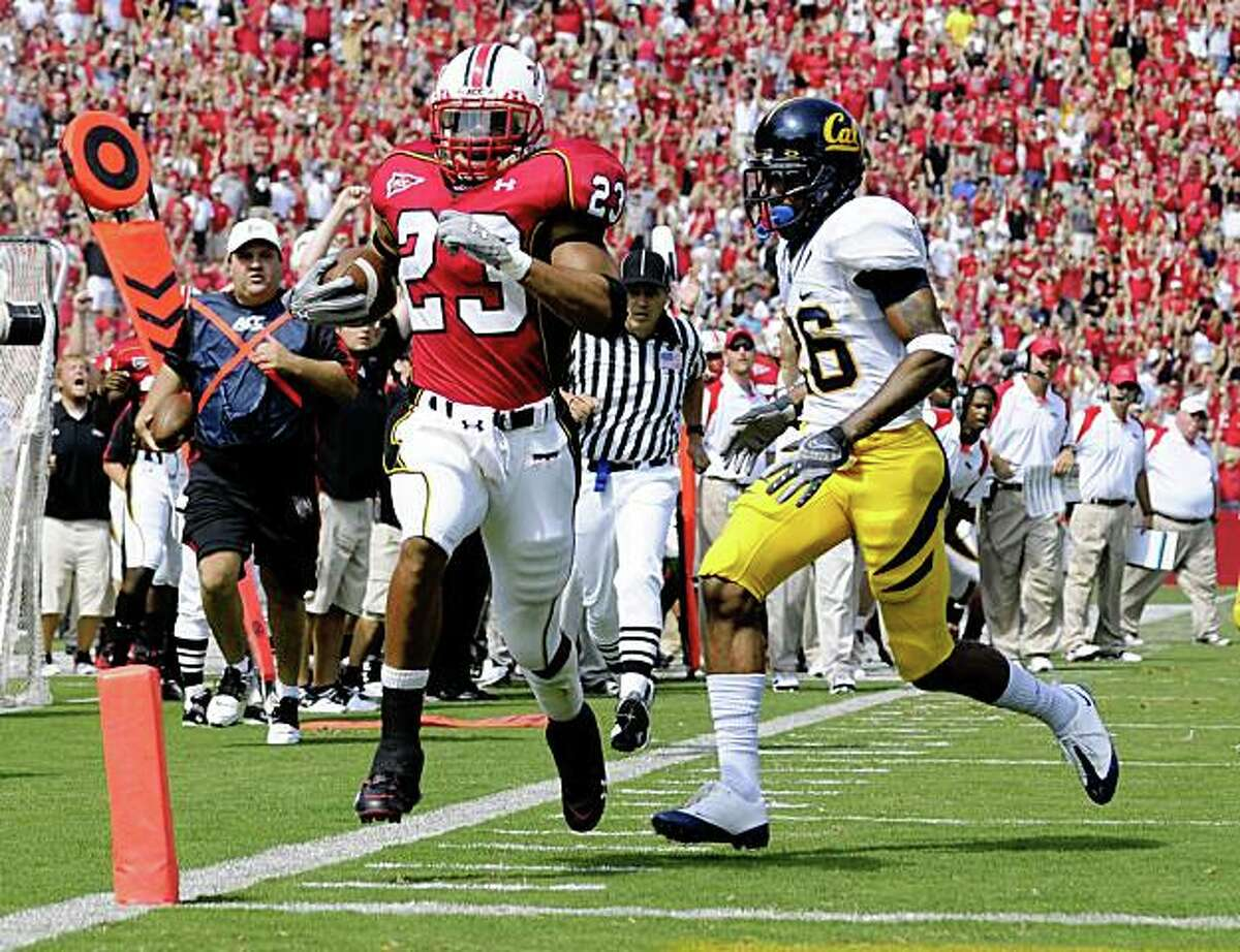 Maryland running back Da'Rel Scott (23) runs in for a touchdown against California cornerback Darian Hagan (26) during the first quarter of an NCAA college football game Saturday, Sept. 13, 2008, in College Park, Md. (AP Photo/Nick Wass)