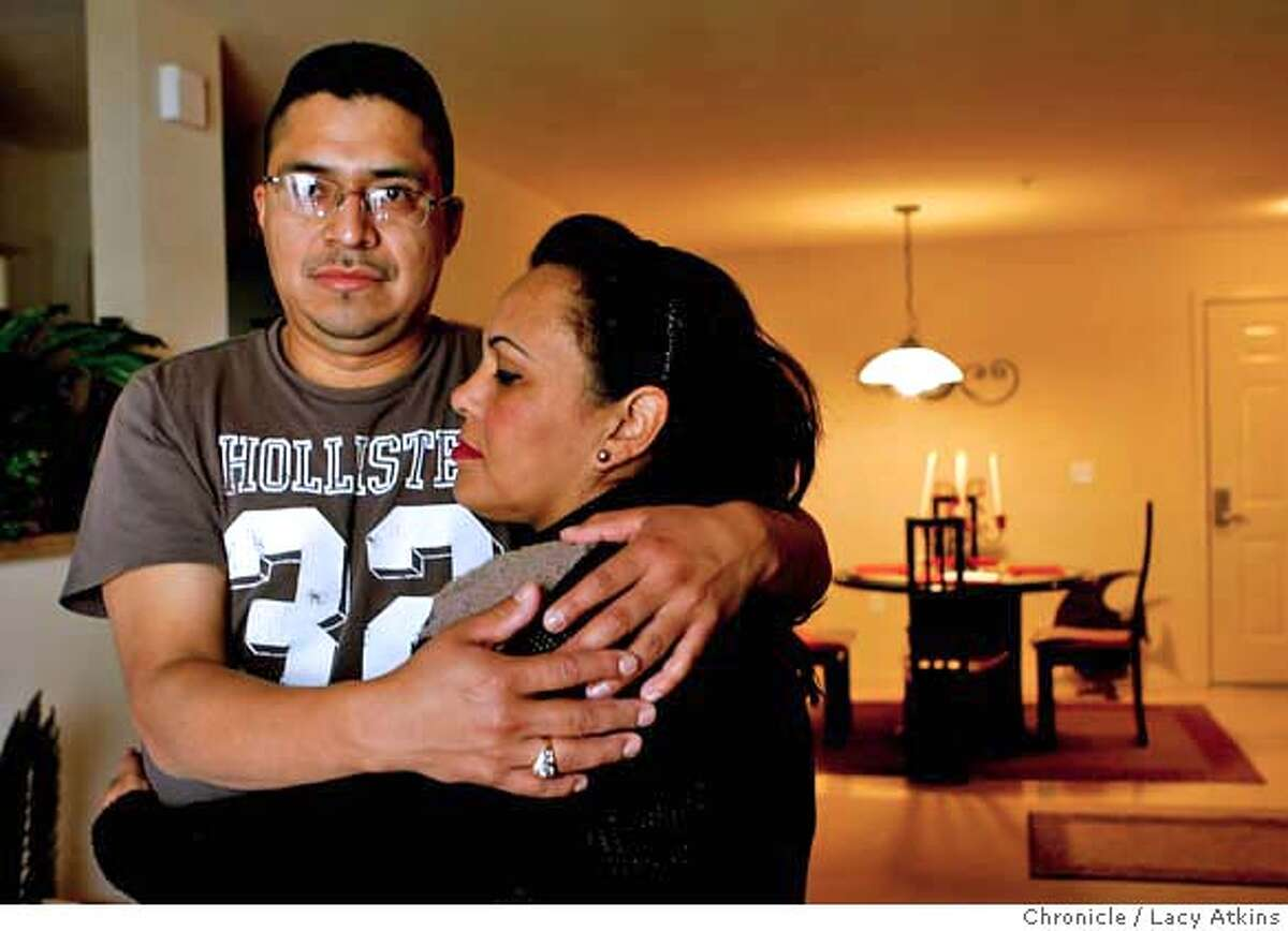 Raul Gonzalez and his wife Margarita Narvaez moved into their new apartment four months ago after the foreclosure of the home, Tuesday April 22, 2008, in San Jose, Calif. Lacy Atkins / San Francisco Chronicle Ran on: 04-23-2008 Raul Gonzalez hugs wife Margarita Narvaez in the apartment they moved to after foreclosure.