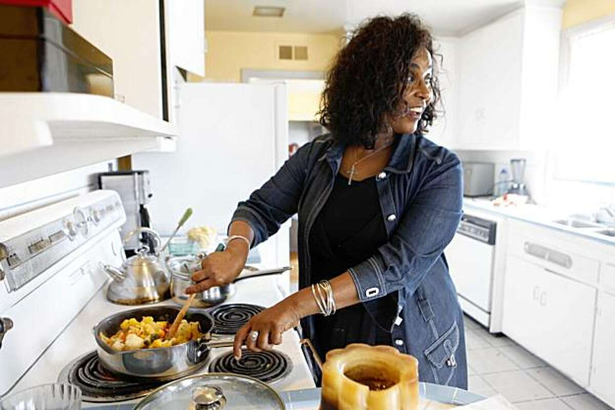 Netsanet Alemayehu from Sheba piano Lounge cooks her Cauliflower Warm Salad in her home on Monday Aug. 24, 2009 in San Francisco, Calif.