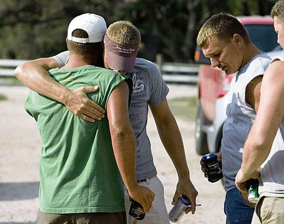 James Phillips, right, and Curt Hall, left, two of three fisherman who were rescued after eight days adrift in the Gulf of Mexico, reunite with Ben Walker, center, at a homecoming party at the Phillips' home Sunday, Aug. 30, 2009, in Blessing, Texas. Photo: James Nielsen, Houston Chronicle