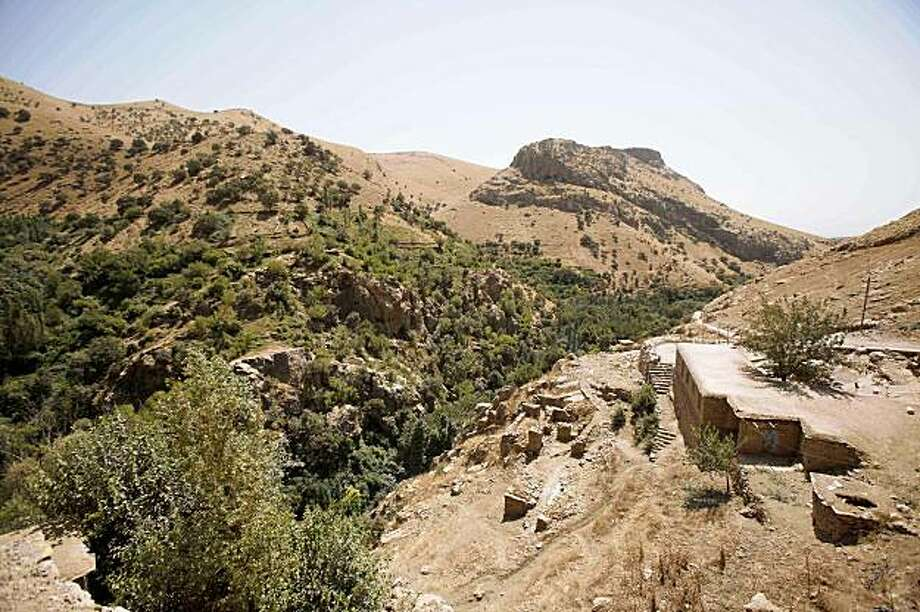 A general view of the Iran-Iraq border where three American hikers disappeared near Sulaimaniyah, 260 kilometers (160 miles) northeast of Baghdad, Iraq is shown Tuesday, Aug. 4, 2009. Despite a fledgling tourism boom, going off the beaten path in Kurdistan is a highly risky endeavor, as three Americans discovered after they apparently wandered down the wrong side of a mountain last week and were taken into custody by Iranian border guards. (AP Photo/Hadi Mizban) Photo: Hadi Mizban, AP