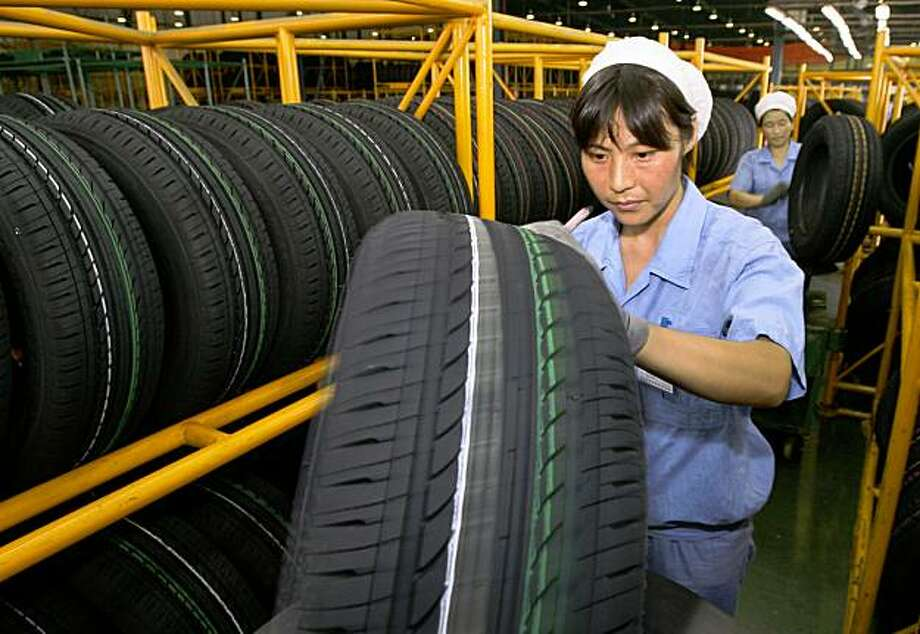 (FILES) This file photo taken on July 25, 2007 shows workers conducting quality control checks on their tyres at a factory in Hangzhou.  The Chinese embassy said on September 14, 2009 that Beijing had lodged a formal complaint at the World Trade Organisation against the United States over tariffs imposed by Washington on Chinese tyre imports.     AFP PHOTO / FILES / Mark RALSTON (Photo credit should read MARK RALSTON/AFP/Getty Images) Photo: Mark Ralston, AFP/Getty Images