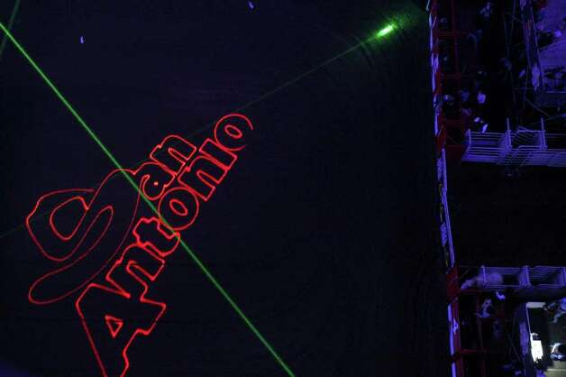 A view of the laser and pyrotechnic show during the San Antonio Stock Show & Rodeo on Thursday, Feb. 9, 2012 at the AT&T Center. Photo: EDWARD A. ORNELAS, SAN ANTONIO EXPRESS-NEWS / © SAN ANTONIO EXPRESS-NEWS (NFS)