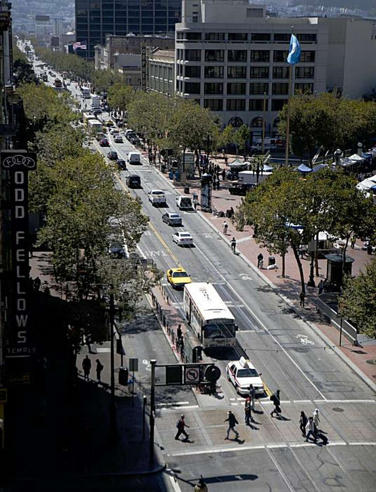 Cars, Cable cars and pedestrian share the Market Street on Wednesday Sep. 9, 2009 in San Francisco, Calif. Starting Sept. 29 Market Street will be closed to cars heading westbound from Van Ness to the Embarcadero and eastbound traffic will have to turn right on 6th,8th or 10th. The pilot project is expected to become permanent and art installations and places for public concerts should replace cars and traffic.