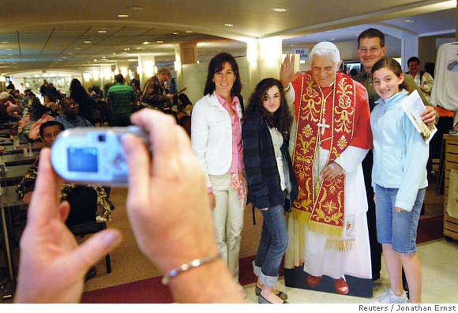 ###Live Caption:A family poses with a cutout of Pope Benedict XVI in the gift shop of the Basilica of the National Shrine of the Immaculate Conception in Washington, April 13, 2008. The Pope will be visiting Washington on his first visit to the United States as Pope this week, holding an outdoor mass and meeting with US President George W. Bush at the White House. REUTERS/Jonathan Ernst (UNITED STATES)###Caption History:A family poses with a cutout of Pope Benedict XVI in the gift shop of the Basilica of the National Shrine of the Immaculate Conception in Washington, April 13, 2008. The Pope will be visiting Washington on his first visit to the United States as Pope this week, holding an outdoor mass and meeting with US President George W. Bush at the White House. REUTERS/Jonathan Ernst (UNITED STATES)###Notes:A family poses with a cutout of Pope Benedict XVI in the gift shop of the Basilica of the National Shrine of the Immaculate Conception in Washington###Special Instructions:0 Photo: JONATHAN ERNST