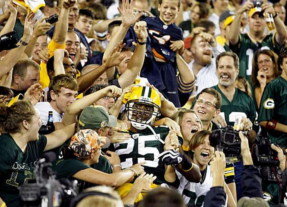 Green Bay Packers running back Ryan Grant celebrates with fans after rushing for a touchdown during the first half of an NFL football game against the Chicago Bears on Sunday, Sept. 13, 2009, in Green Bay, Wis. (AP Photo/Jeffrey Phelps) Photo: Jeffrey Phelps, AP
