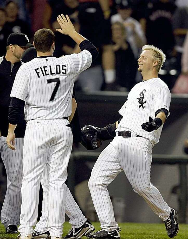 Chicago White Sox's Josh Fields gets ready to congratulate A.J. Pierzynski after Pierzynski drove in the winning run against the Oakland Athletics in the 13th inning of a baseball game Wednesday, Sept. 9, 2009, in Chicago.  The White Sox defeated the Athletics 4-3.(AP Photo/Jim Prisching) Photo: Jim Prisching, AP