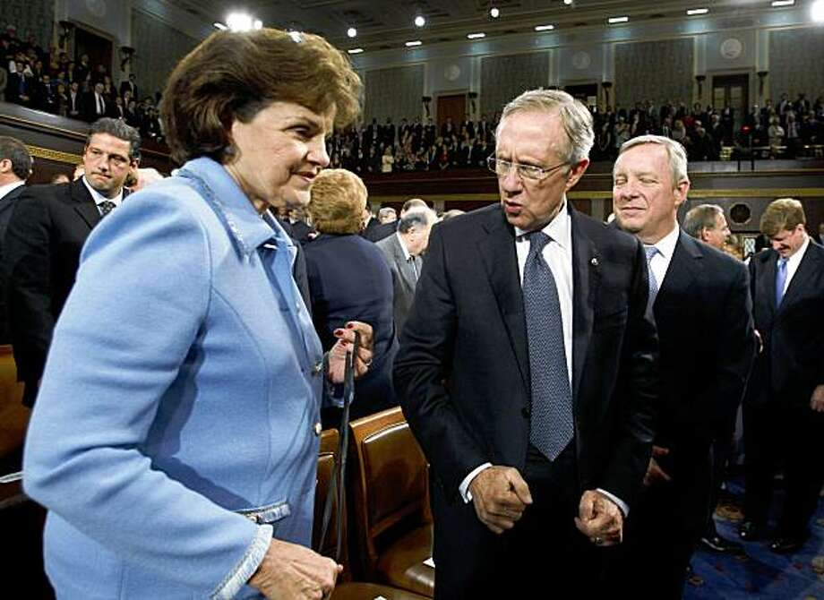 Sen. Dianne Feinstein, D-Calif., talks with Senate Majority Leader Harry Reid and Majority Whip Dick Durbin on the floor of the House Chamber before a joint session of the Congress on Capitol Hill in Washington, Wednesday, Sept. 9, 2009. Photo: Jason Reed, Associated Press