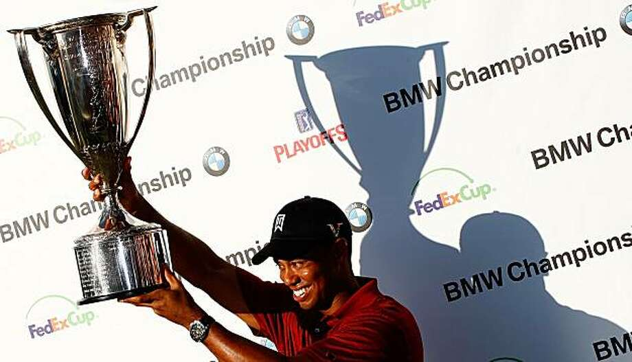 Tiger Woods poses with the J.K. Wadley trophy after his eight-stroke victory at the BMW Championship held at Cog Hill Golf & CC on September 13, 2009 in Lemont, Illinois. Photo: Scott Halleran, Getty Images