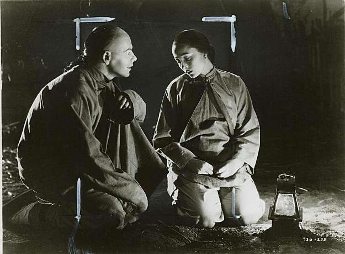 Paul Muni and Luise Rainer in