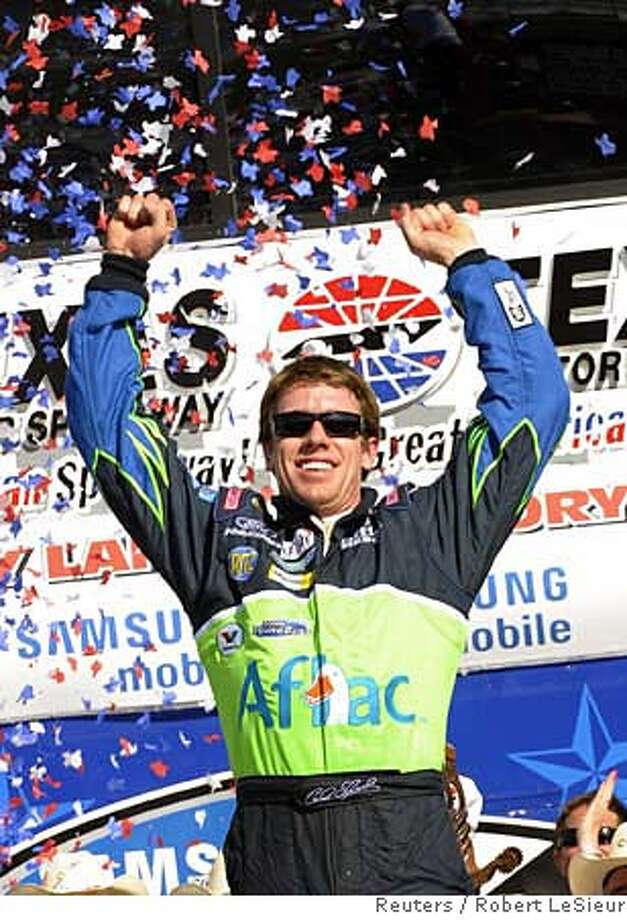 ###Live Caption:Carl Edwards celebrates in victory lane after winning the NASCAR Sprint Cup, Samsung 500 race at Texas Motor Speedway in Fort Worth, Texas, April 6, 2008. REUTERS/Robert LeSieur (UNITED STATES)###Caption History:Carl Edwards celebrates in victory lane after winning the NASCAR Sprint Cup, Samsung 500 race at Texas Motor Speedway in Fort Worth, Texas, April 6, 2008. REUTERS/Robert LeSieur (UNITED STATES)###Notes:Carl Edwards celebrates in victory lane after winning the NASCAR Sprint Cup, Samsung 500 race at Texas Motor Speedway in Fort Worth###Special Instructions: Photo: ROBERT LESIEUR