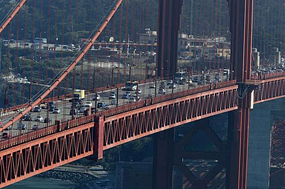 Traffic moves over the Golden Gate Bridge on Friday. Photo: Mike Kepka, The Chronicle