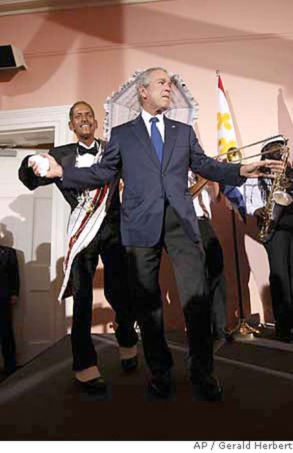 ###Live Caption:President Bush dances with members of the Euphonic Brass Band during a reception at Gallier Hall in New Orleans, Monday, April 21, 2008. (AP Photo/Gerald Herbert)###Caption History:President Bush dances with members of the Euphonic Brass Band during a reception at Gallier Hall in New Orleans, Monday, April 21, 2008. (AP Photo/Gerald Herbert)###Notes:George W. Bush, Tom Donohue###Special Instructions: Photo: Gerald Herbert