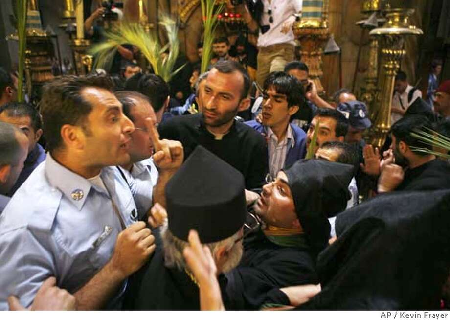 ###Live Caption:An Israeli police officer, left, tries to break up a fight between Greek and Armenian clergymen during Palm Sunday processions for Orthodox Holy Week, at the Church of the Holy Sepulcher, traditionally believed by many to be the site of the crucifixion of Jesus Christ in Jerusalem, Sunday April 20, 2008. Greek and Armenian priests scuffled at Christianity's holiest site on Palm Sunday over who'll get to spend more time at the traditional tomb of Jesus. The Church of the Holy Sepulcher is jointly administrated by different Christian denominations. Fights often erupt during religious ceremonies over shared space or time.(AP Photo/Kevin Frayer)###Caption History:An Israeli police officer, left, tries to break up a fight between Greek and Armenian clergymen during Palm Sunday processions for Orthodox Holy Week, at the Church of the Holy Sepulcher, traditionally believed by many to be the site of the crucifixion of Jesus Christ in Jerusalem, Sunday April 20, 2008. Greek and Armenian priests scuffled at Christianity's holiest site on Palm Sunday over who'll get to spend more time at the traditional tomb of Jesus. The Church of the Holy Sepulcher is jointly administrated by different Christian denominations. Fights often erupt during religious ceremonies over shared space or time.(AP Photo/Kevin Frayer)###Notes:###Special Instructions: Photo: KEVIN FRAYER