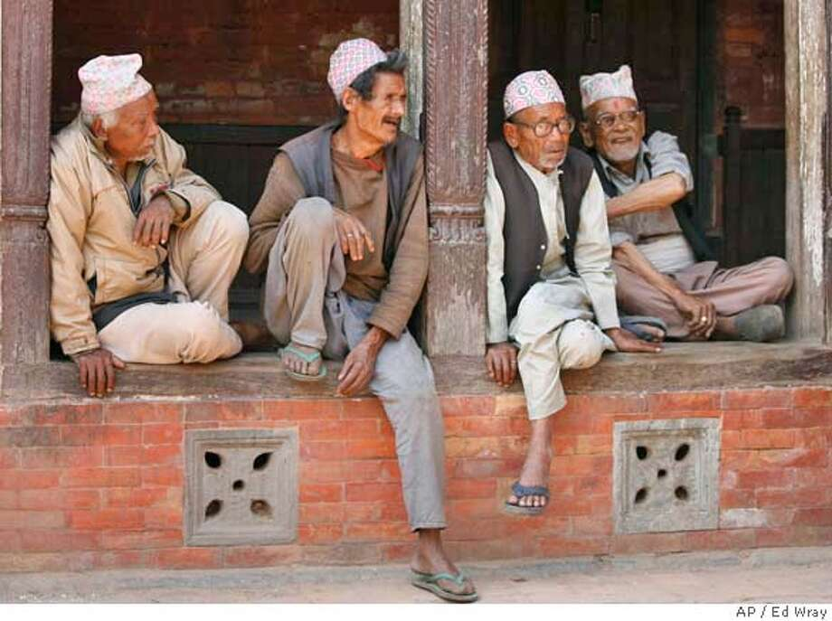 ###Live Caption:Nepalese men joke and chat Wednesday, April 9, 2008, in Bhaktapur, Nepal. Violence on the eve of a landmark election meant to cement a peace deal with Nepal's communist insurgents left at least seven people dead, officials said Wednesday, with police killing at least one protester and six former rebels in separate clashes.(AP Photo/Ed Wray)###Caption History:Nepalese men joke and chat Wednesday, April 9, 2008, in Bhaktapur, Nepal. Violence on the eve of a landmark election meant to cement a peace deal with Nepal's communist insurgents left at least seven people dead, officials said Wednesday, with police killing at least one protester and six former rebels in separate clashes.(AP Photo/Ed Wray)###Notes:###Special Instructions: Photo: Ed Wray