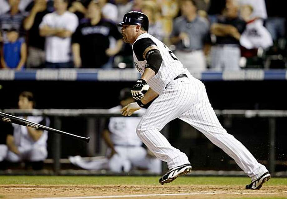 Colorado Rockies pinch-hitter Jason Giambi watches his two-run single against the New York Mets in the eighth inning of the Rockies' 5-2 victory in a baseball game in Denver on Wednesday, Sept. 2, 2009. (AP Photo/David Zalubowski) Photo: David Zalubowski, AP