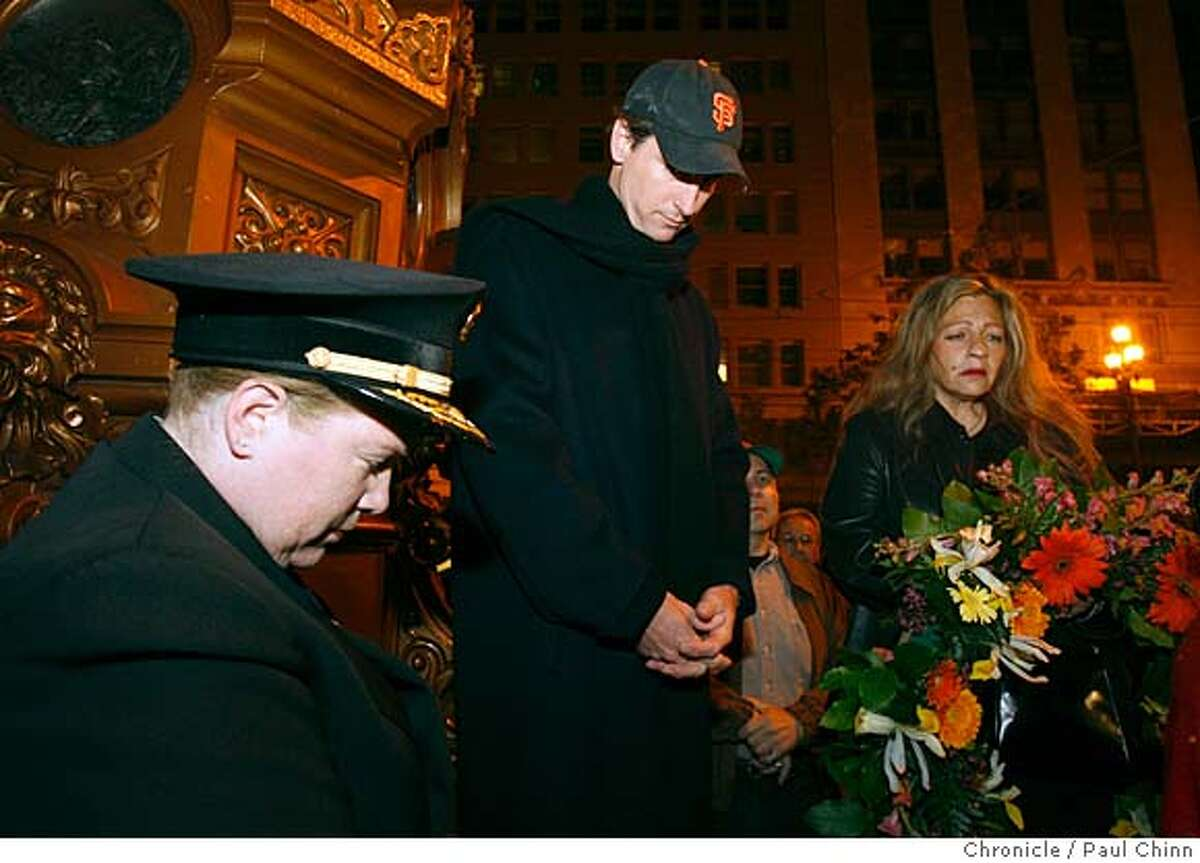 Fire Chief Joanne Hayes White, Mayor Gavin Newsom and Taren Sapienza, the producer of the event, bow their heads for a moment of silence at precisely 5:12 a.m. during the ceremony at Lotta's Fountain to commemorate the 102nd anniversary of the 1906 earthquake in San Francisco, Calif., on Thursday, April 17 2008. Photo by Paul Chinn / San Francisco Chronicle