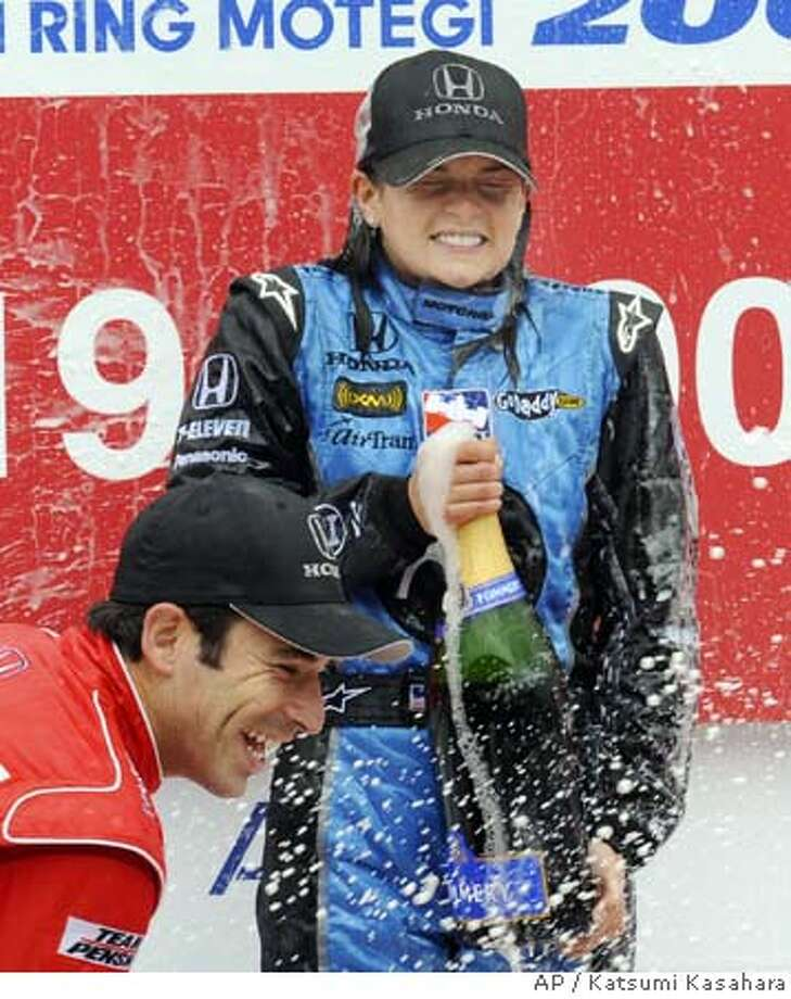 ###Live Caption:American Danica Patrick of Andretti Green Racing sprays champagne with second-place Brazil's Helio Castroneves of Team Penske on the podium after winning the Indy Japan 300 auto racing at Twin Ring Motegi in Motegi, northeast of Tokyo Sunday, April 20, 2008. Patrick became the first female winner in IndyCar history Sunday, taking the Indy Japan 300 after the top contenders were forced to pit for fuel in the final laps. (AP Photo/Katsumi Kasahara)###Caption History:American Danica Patrick of Andretti Green Racing sprays champagne with second-place Brazil's Helio Castroneves of Team Penske on the podium after winning the Indy Japan 300 auto racing at Twin Ring Motegi in Motegi, northeast of Tokyo Sunday, April 20, 2008. Patrick became the first female winner in IndyCar history Sunday, taking the Indy Japan 300 after the top contenders were forced to pit for fuel in the final laps. (AP Photo/Katsumi Kasahara)###Notes:Danica Patrick###Special Instructions: Photo: Katsumi Kasahara