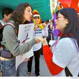 Samantha Weintraub of San Francsico, left, argues with Min Liu of Santa Clara, right, as pro-China and anti-China protesters clash on Third Street north of the Lefty O' Doul Bridge in San Francisco, Calif. on Wednesday April 9, 2008 in anticipation of the passing of the Olympic torch. Photo by Kim Komenich / San Francisco Chronicle