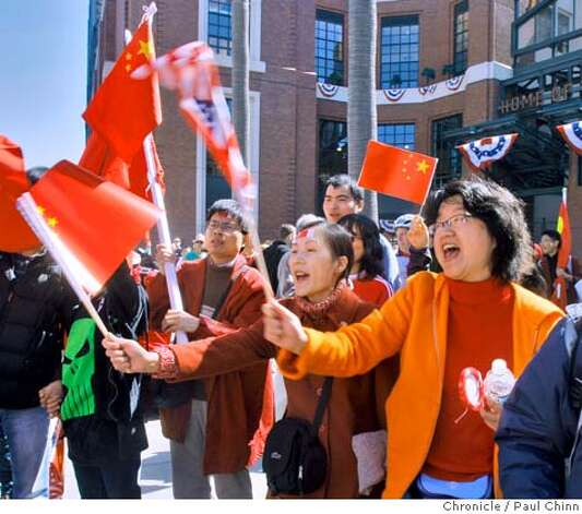 Pro-China demonstrators shout at Tibetan protesters at Willie Mays Plaza before the Olympic torch relay in San Francisco, Calif., on Wednesday, April 9, 2008.  Photo by Paul Chinn / San Francisco Chronicle Photo: Paul Chinn