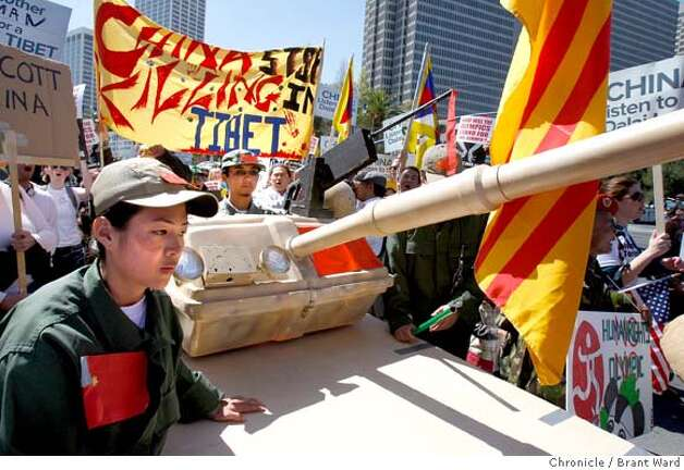 A tank was used by pro-Tibet protesters as they marched down the Embarcadero. Thousands of protesters on both sides of the China issue protested near the Ferry building in San Francisco Wednesday, April 9, 2008. Photo by Brant Ward / San Francisco Chronicle Photo: Brant Ward