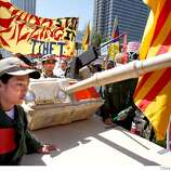 A tank was used by pro-Tibet protesters as they marched down the Embarcadero. Thousands of protesters on both sides of the China issue protested near the Ferry building in San Francisco Wednesday, April 9, 2008. Photo by Brant Ward / San Francisco Chronicle