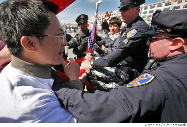 Pro-China and anti-China protesters clash on Third Street south of the Lefty O' Doul Bridge in San Francisco, Calif. on Wednesday April 9, 2008 in anticipation of the passing of the Olympic torch. Photo by Kim Komenich / San Francisco Chronicle Photo: Kim Komenich
