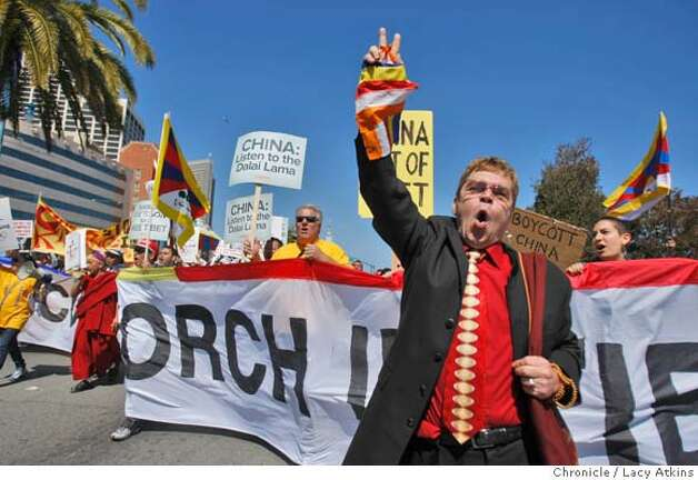 Richard Furgeson, also known as Eldon John, march with thousands of protesters down the Embarcadero between Howard and Folsom Streets before the Beijing Olympic torch is carried along the waterfront, Wednesday April 9, 2008, in San Francisco, Calif. Photo: Lacy Atkins