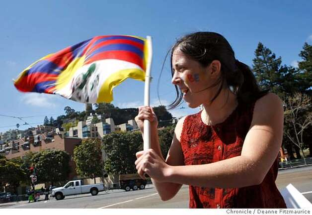 Isabel Rodriguez-Vega, 17, from Oakland waves a Tibetan flag along the proposed route along the Embarcadero at Sansome on April 9, 2008 in San Francisco, Calif. Photo by Deanne Fitzmaurice / San Francisco Chronicle Photo: Deanne Fitzmaurice