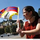 Isabel Rodriguez-Vega, 17, from Oakland waves a Tibetan flag along the proposed route along the Embarcadero at Sansome on April 9, 2008 in San Francisco, Calif. Photo by Deanne Fitzmaurice / San Francisco Chronicle
