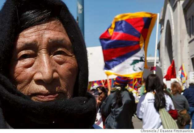 Cho Lhamo moved to the Bay area from Tibet in 1959. The Olympic torch is carried through the streets on April 9, 2008 in San Francisco, Calif. Photo by Deanne Fitzmaurice / San Francisco Chronicle Photo: Deanne Fitzmaurice
