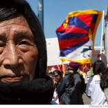 Cho Lhamo moved to the Bay area from Tibet in 1959. The Olympic torch is carried through the streets on April 9, 2008 in San Francisco, Calif. Photo by Deanne Fitzmaurice / San Francisco Chronicle