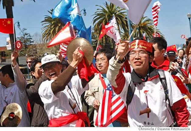 Pro-Chinese supporters yelled to the Tibetan supporters on Embarcadero at Battery. The Olympic torch is carried through the streets on April 9, 2008 in San Francisco, Calif. Photo by Deanne Fitzmaurice / San Francisco Chronicle Photo: Deanne Fitzmaurice
