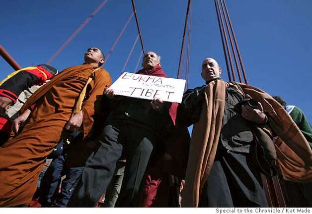 From left, Burmese monk, Ashin Nanikabhivamsa along with budhist budhist clergy lead a meditative peace walk across the Goloden Gate Bridge in San Francisco, Calif. on Wednesday, April 9, 2008.  Photo by Kat Wade / Special to the Chronicle Photo: Kat Wade