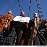 From left, Burmese monk, Ashin Nanikabhivamsa along with budhist budhist clergy lead a meditative peace walk across the Goloden Gate Bridge in San Francisco, Calif. on Wednesday, April 9, 2008.  Photo by Kat Wade / Special to the Chronicle