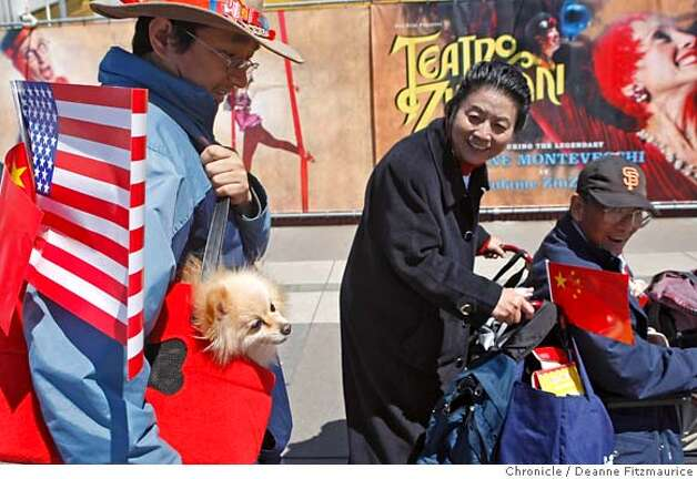 Scott Joe and his dog Peppy drew a lot of attention as the crowd gathered where they expected to see the Olympic torch pass by at Battery and Embarcadero on April 9, 2008 in San Francisco, Calif. Photo by Deanne Fitzmaurice / San Francisco Chronicle Photo: Deanne Fitzmaurice