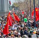 The sidewalks and streets were very crowded with people making a visit by the torch virtually impossible. Thousands of protesters on both sides of the China issue protested near the Ferry building in San Francisco Wednesday, April 9, 2008. Photo by Brant Ward / San Francisco Chronicle