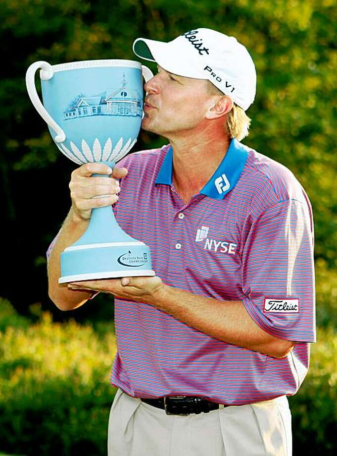 Steve Stricker kisses the trophy after winning the Deutsche Bank Championship golf tournament with 17-under par, Monday, Sept. 7, 2009, in Norton, Mass. (AP Photo/Michael Dwyer) Photo: Michael Dwyer, AP