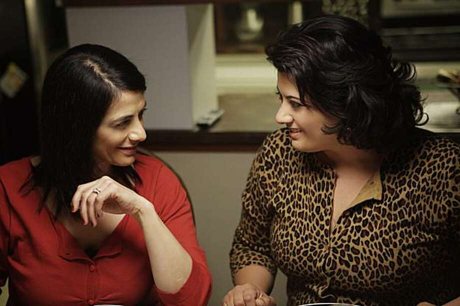 "Raghda (Hiam Abbass) talks with her sister Muna (Nisreen Faour) in Cherien Dabis' film, ""Amreeka."" Photo: National Geographic Films"